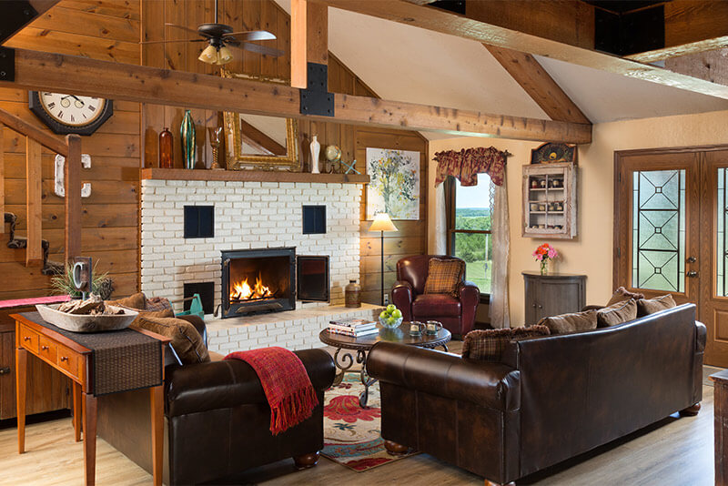 Sit fireside and relax in the Common Room of Cedar Crest Lodge.