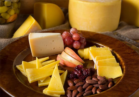 Cheese, fruit, and nuts on a plate