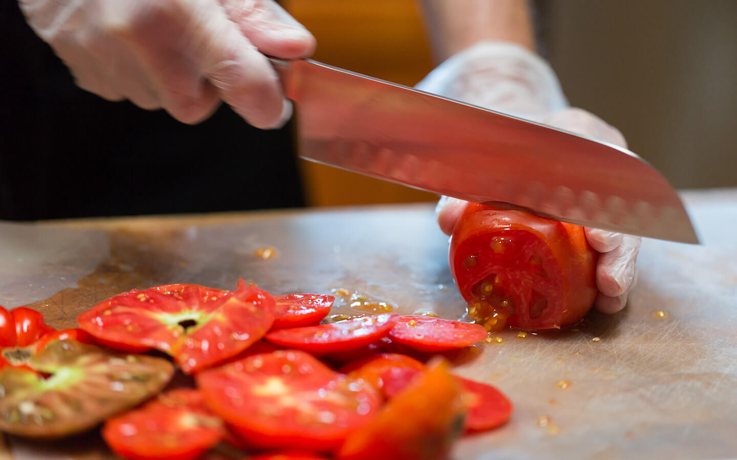 Chef slicing vegetables for an Italian cooking class in Kansas