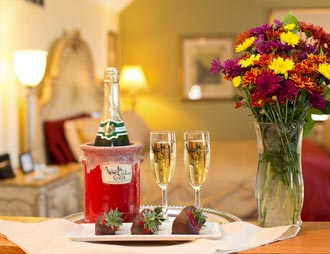 Champagne, flowers, and chocolate dipped strawberries