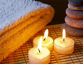 Spa towels, candles, and stones