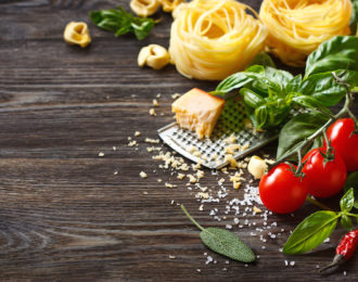 Italian food ingredients for cooking pasta on a wooden background with copy space. ** Note: Shallow depth of field
