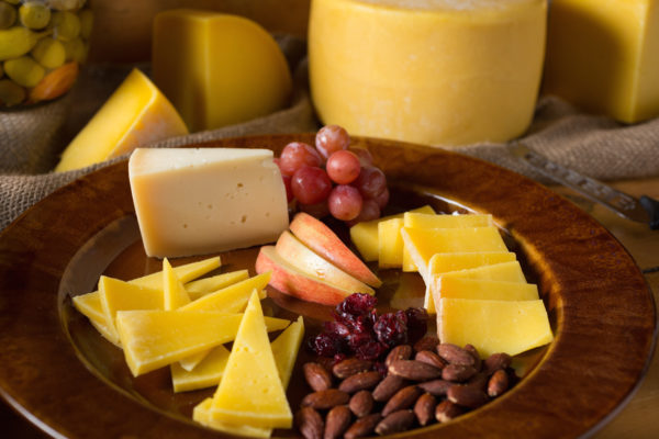 Cheese, fruits, and nuts on a plate