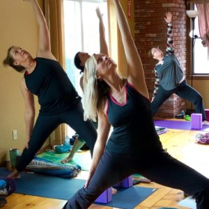 Women practicing yoga at Kansas Yoga Retreat Center