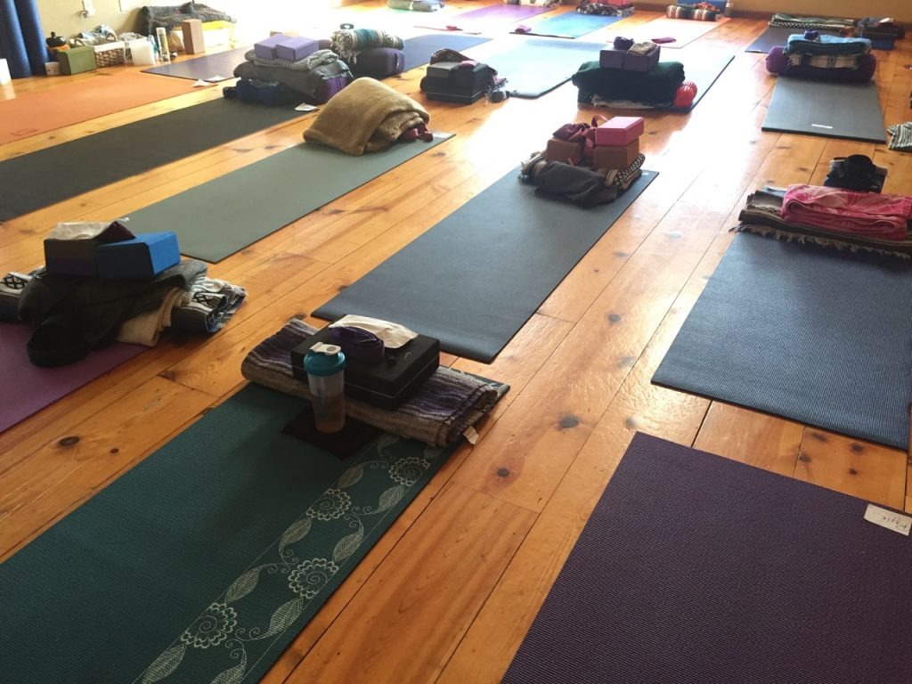 Yoga retreat center room line with yoga mats and supplies