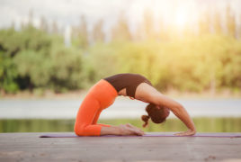 Woman practicing yoga outside at a yoga retreat center