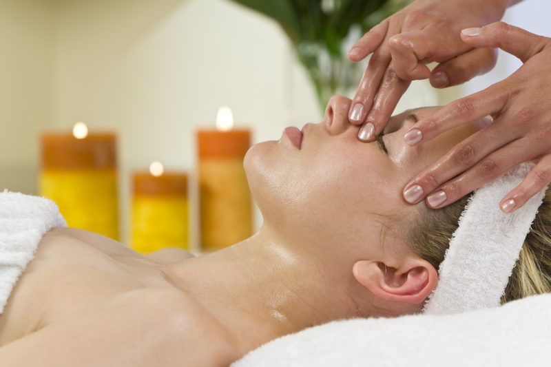 Woman receives facial treatment during her fall getaway at Cedar Crest Lodge.