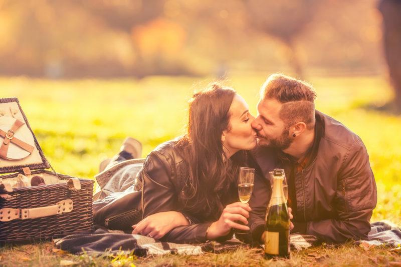 Couple enjoying a romantic autumn picnic at Cedar Crest Lodge.