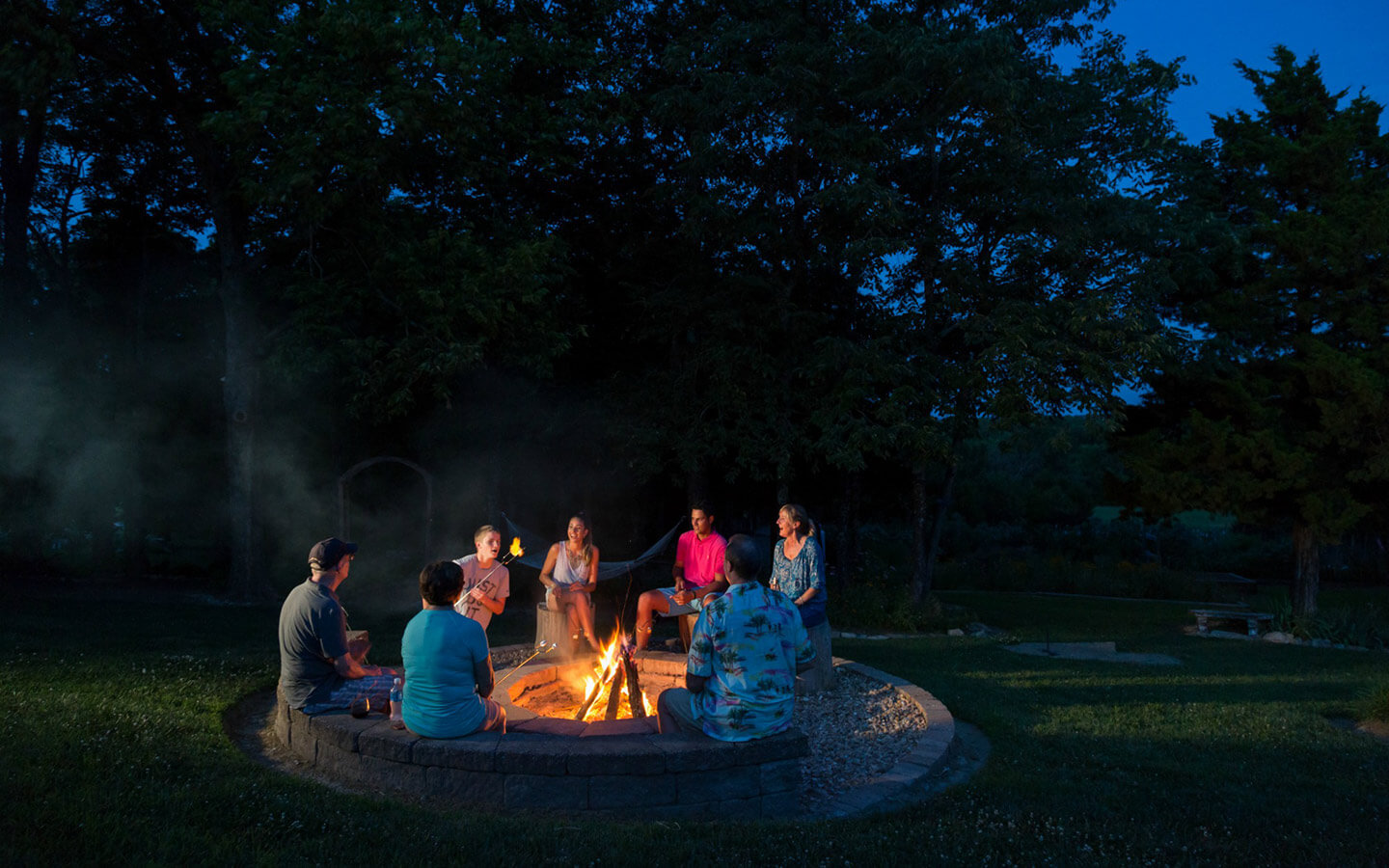 People sitting around the firepit