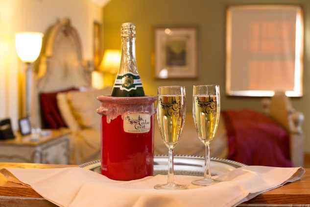 Bottle of Champagne and two flutes in Cedar Crest Lodge room